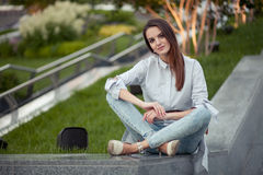 Young adult hispanic female in park outdoor Royalty Free Stock Photos