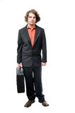 Young adult holding briefcase Royalty Free Stock Photo