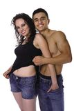 Young adult holding each other. Foreplay, young couple holding each other, isolated on whte Royalty Free Stock Photo