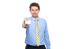 Young adult holds business card, isolated Royalty Free Stock Photography