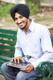 Young adult indian sikh man Royalty Free Stock Photos