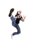 Young adult jumping. Young adult wearing casual clothes, jumping (dancing Stock Photography