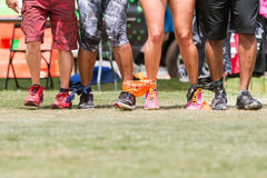 Young Adult Legs Walk In Unison At Five-Legged Race Royalty Free Stock Images
