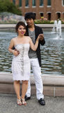 Young adult lovers in front of water fountain Royalty Free Stock Images