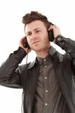 Young adult male listening music Stock Images