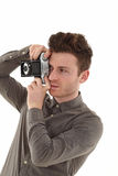 Young adult male with olf film camera Stock Photo