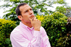 Young adult male thinking. With collared shirt Stock Images