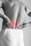 Young adult man with backache. Black Stock Images
