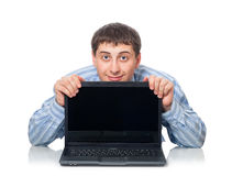 Young adult man behind the laptop Stock Images
