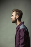 Young adult man on a dark background Royalty Free Stock Photo