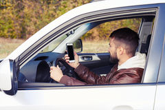 Young adult man driving his car Royalty Free Stock Photography