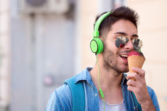 Young Adult Man Eating Ice-Cream Stock Images