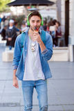 Young Adult Man Eating Ice-Cream Royalty Free Stock Images