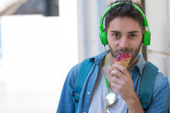 Young Adult Man Eating Ice-Cream Royalty Free Stock Photos