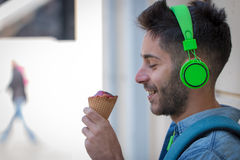 Young Adult Man Eating Ice-Cream Stock Photography