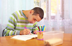 Young adult man engages in self study, in rehabilitation center. Young man engages in self study, in rehabilitation center Stock Photo