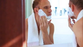 Young adult man foamed face before shaving stock video