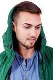 Young adult man with green jacket portrait isolated Stock Image