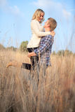 Young adult man holding his girlfriend up Stock Image