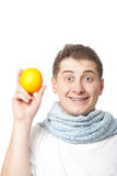 Young adult man holding orange Royalty Free Stock Photos