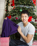 Young Adult Man with Holiday Gifts Stock Image