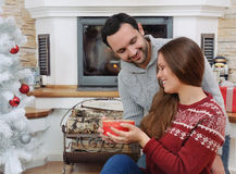 The young adult man make present his girlfriend Stock Images