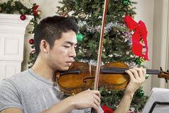 Young Adult Man Playing Music During the Holidays Stock Image