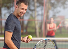 Young adult man playing tennis and preparing for sports competition. Stock Images