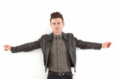 Young adult man posing with leather Royalty Free Stock Photos