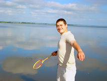 Young adult man with a racket . Royalty Free Stock Photography