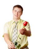 Young adult man with red rose Stock Images
