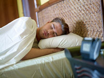 Young adult man sleeping Stock Image