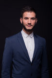 Young adult man smirking suit elengant Royalty Free Stock Image