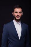 Young adult man smirking suit elengant Stock Photos
