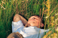 Young adult man in spring grass Stock Photos