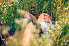 Young adult man in spring grass Stock Photo