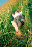 Young adult man in spring grass Stock Photography