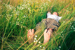 Young adult man in spring grass Stock Images