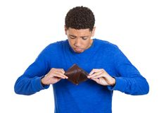 Young adult man standing holding empty wallet Stock Images
