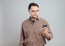 Young adult man using mobile phone Stock Images