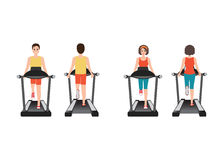 Young adult man and woman running on treadmill. Stock Photos