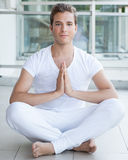 Young adult meditating with hands together Stock Photography