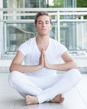 Young adult meditating with hands together Royalty Free Stock Photos