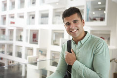 Young adult Middle Eastern male student smiling to camera Stock Photo