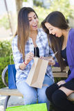 Young Adult Mixed Race Women Looking Into Their Shopping Bags Stock Images