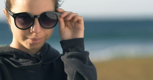 Young adult model woman girl with sunglasses portrait stock video
