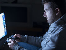 Young adult playing with video-game Royalty Free Stock Images
