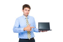 Young adult point to small laptop, 10 inch screen Royalty Free Stock Image