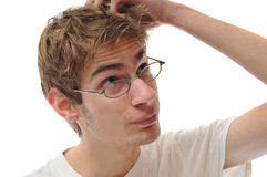 Young Adult Problem Solving. A young white male Caucasian adult scratching head isolated on white Stock Photography