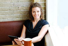 Young adult reading in coffee shop Stock Image